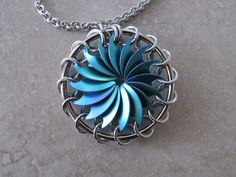 Titanium  Pinwheel Pendant with Chain - Teal by SilverSpringDesignz on Etsy https://www.etsy.com/listing/231108423/titanium-pinwheel-pendant-with-chain
