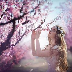 trees flowers girl hair blue sky crown