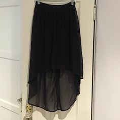 Black sheer hi-low skirt Black hi-low skirt. Has coverage under the top half so no underwear would show. Also has an elastic back top to help with putting on as there is no zippers or buttons Fire Los Angeles Skirts High Low