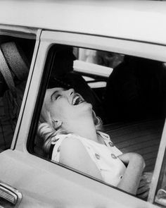 Marilyn Monroe during the filming of The Misfits (notice the cherry patterned dress), 1961. Photo: Ernst Haas.