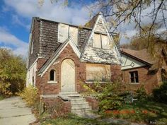 Spacious brick Tudor in Detroit!! Large living room with fireplace, roomy kitchen, dining area, 3 bedrooms and full basement!! Great investment property!!