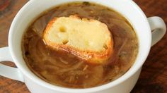 French Onion Soup with Cheesy Croutons - Making tonight to add to Fat Tuesday sausage and shrimp FEAST! (Rachael Ray - onions, butter, garlic, bay leaves, thyme, salt, pepper, wine, soup stock, bread)