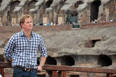Prince Harry is shown around the Colosseum by guide Laura Cignoni on May 19, 2014 in Rome, Italy