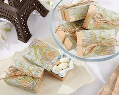 Map Travel Themed Sliding Favor Boxes (Set of 24) (Kate Aspen 28185NA) | Buy at Wedding Favors Unlimited (https://www.weddingfavorsunlimited.com/map_themed_sliding_favor_boxes_set_of_24.html).