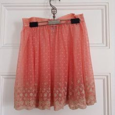 """FP Intimately sheer lace embroidered skirt NWOT Very sheer - gorgeous coral pink with lacy cream embroidered hem. Free People Intimately skater skirt (underskirt or slip). Never worn! NWOT. Measures 16"""" from the waist. Free People Skirts"""