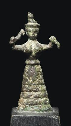 Minoan bronze snake Goddess, Late Minoan I, 1600-1500 B.C. Holding a snake in each of her raised arms, wearing a long flounced skirt and a headdress with tall finial, with pronounced breasts, 5.2 cm high. Private collection