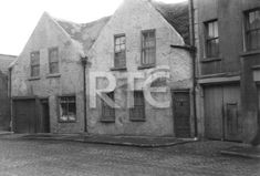 An exterior view of terraced houses on Marrowbone Lane, Dublin city, in 1952 or 1953. Note the cobblestones on the street. Collection RTÉ Johnson Collection Photographer Johnson, Nevill