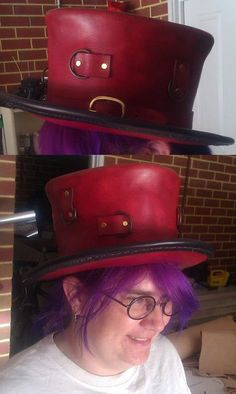Custom made Tophat from Steam Generation   Made with 2.5mm veg tan leather, brass rivets / D rings, hand stitched / dyed red and black