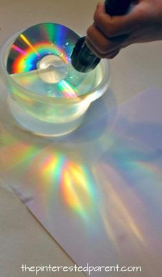 Explore, Paint Rainbows Make a rainbows using a CD and a flashlight or sunlight. Simple science fun for preschoolers and kidsMake a rainbows using a CD and a flashlight or sunlight. Simple science fun for preschoolers and kids Kid Science, Preschool Science, Science Fair, Summer Science, Physical Science, Science Classroom, Science Fiction, Preschool Weather, Rainbow Crafts Preschool