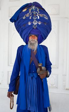 This man is a fully baptized Sikhwhom I met at The Golden Temple. His turban is made of 30 meters of cloth and is decorated with the two primary symbols of Sikhism: the Khanda and the