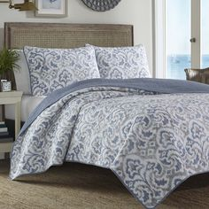 Effortlessly refresh your master suite or guest room in seconds with this lovely cotton quilt set, featuring an ikat damask pattern that reverses to a solid ...