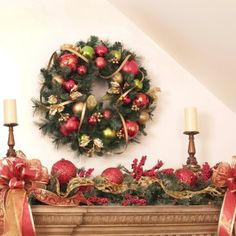 "Christmas Ornament Holiday Wreath CR1018. 24"" Ornament Pine wreath says Christmas! The Red, Gold and Green designer ornaments will add delight to your holiday season. This lush pine wreath is accented with gold Trim."