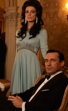 Amazing.  I need this dress.  And the hair.  And the earrings.  And Jon Hamm.