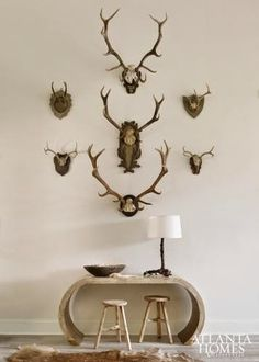 Small and large wall-mounted horns mingle to create one cohesive statement in the foyer. Stools, South of Market. Types Of Furniture, Design Furniture, Rustic Furniture, Furniture Ideas, Interior Design Portfolios, Lakefront Homes, Foyer Decorating, Decorating Ideas, Atlanta Homes