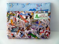 These stuff holders are made from stuffing a cereal bag with plastic scraps then fusing them together to create one piece of fabric which can be sewn into a quirky case.