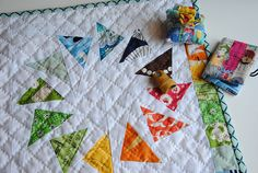 I like the grid hand-quilting over the flying geese -- very nice
