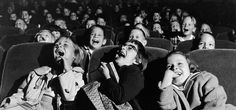 Audience of children laughing in a cinema