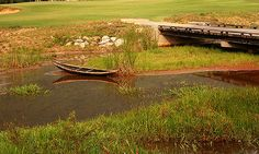 A small local boat adds a nice touch to the natural wetlands flanking the course Lang Co, Golf Courses, Boat, Touch, Group, Landscape, Nice, Natural, Design