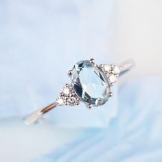 Aquamarine engagement ring in white gold Cluster engagement ring Simple oval cut Dainty Diamond Wedding For wo Perfect Engagement Ring, Engagement Ring Cuts, Solitaire Engagement, Aquamarine Engagement Rings, Aquamarine Wedding, Wedding Rings Simple, Antique Engagement Rings, Ring Verlobung, Bridal Rings