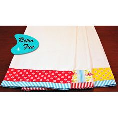 Quick & Easy Fabric Project 8.                  Fabric trimmed tea towels - cute