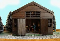 Blacksmith in Christmas village   - Moving Diorama -  The blacksmith is always working in his forge. -  Actieve diorama's - Fantasiorama - Art of Engineering