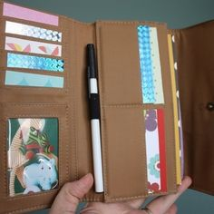 "Put together a ""busy wallet"" with drawing paper, fun stickers, and a pen."