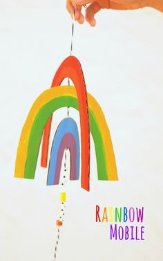How to make an easy, breezy, cardboard rainbow mobile- Super pretty and fun art project to make with kids of all ages!
