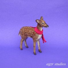 """A. Gabriela Z. Rodríguez, AGZR studio - """"Rudolf"""" is a One of a kind polymer clay sculpture. He has been sculpted entirely by hand, baked, then a coat of natural fur was applied layer by layer. sold on ebay for $474.99"""