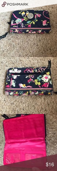 Vera Bradley floral turn lock wallet Pre loved. Some signs of wear are on the outside. Edges are a little worn and minor scuffing on the metal. Slightly faded. It's still in good condition overall and the inside looks new. Authentic Vera Bradley Bags Wallets