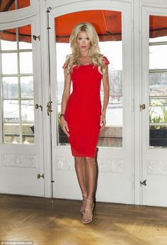 Sizzling! Posing at the Manor at Grand Hotel in Stockholm, Sweden, on Tuesday, Victoria Silvstedt put on a particularly racy display in a tight red frock