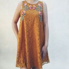"HP Lace Embroidered Dress Lace dress in a mustard yellow color. Embroidered floral detailing at neckline. Fully lined. Button closure on back. New with tags. No size tag present, but fits like a small. Measurements: {Bust: 18""} {Length: 32""} Make a reasonable offer via ""offer"" button.        Discount on bundles!                                               No trades. Dresses"