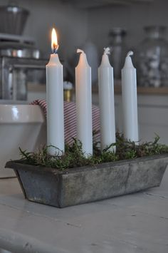 Advent candles in an old cake tin