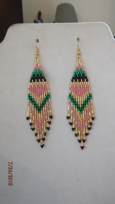 These Native Beaded Purple Earrings are custom made it Silver lined Gold, Peach and Emerald Silver Lined Gold Bugle Beads on them. Beaded Earrings Native, Beaded Earrings Patterns, Beaded Tassel Earrings, Seed Bead Earrings, Jewelry Patterns, Beading Patterns, Beaded Jewelry, Handmade Jewelry, Emerald Earrings