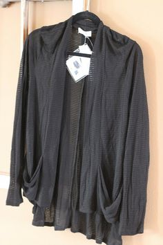 cute cardigan!  Would be fun to see in different colors. Not sure if it's more of a winter weight or summer weight...