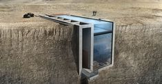 Two Greek architects have created a striking house design called 'Casa Brutale' that perfectly complements the powerful concrete style known as brutalism – they've embedded their luxury brutalist home into a cliff, creating a severe yet inviting structure with an at once beautiful and terrifying view.
