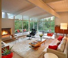 MCM lounge with vaulted ceilings, large windows and fireplace. awesome!