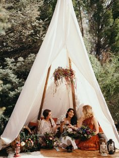 Summer Solstice Inspiration // Boho bride with wine and her brides! A great way to relax before the wedding in a camping inspired teepee with florals and lanterns