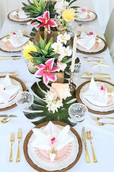 Palm leaves, tropical flowers, golden pineapples, wicker, seashells wedding centerpiece / http://www.himisspuff.com/green-tropical-leaves-wedding-ideas/5/