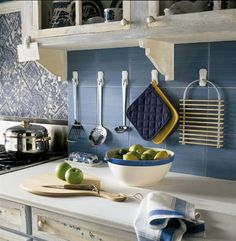 Hang frequently used untensils and other kitchen items up on your back splash - another great convenient idea using Command(TM) Hooks!