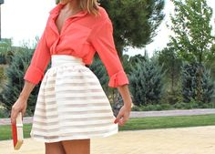 bright blouse and a-line skirt