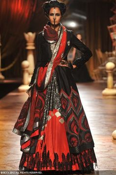A model showcases a creation by designer duo Shantanu and Nikhil