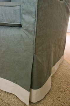 linen piped slipcover with pleat and contrast banding