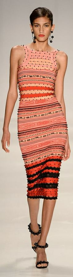 Really like the peachy orange colours in this dress, and how the earrings and…