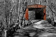 Old Red Bridge by Gallery Three Photography by Tom Gari. Thomas Mill Covered Bridge is the only covered bridge still standing within the city limits of Philadelphia. The bridge is surrounded by Fairmount Park and displays unusual sawtooth decorations. The 86.5-foot-long (26.4 m), 18.66-foot-wide (5.69 m), Howe-truss bridge was built in 1855. It was renovated by the Works Progress Administration in 1939, and by the City of Philadelphia in 2000.