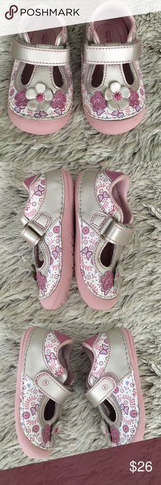 EUC-Pink Cynthia Leather Stride Rite Shoes Pair of pink, mauve, and purple leather stride rite shoes with a metallic sheen to them.  Have 3 flowers at the front with a floral and butterfly pattern around.  Velcro closure with pink soles. In excellent condition!! Stride Rite Shoes Baby & Walker
