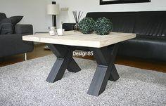 Stoere en industriële salontafel met eikenhouten blad en een stalen onderstel in de vorm van een X. De salontafel is te bestellen via http://www.design85.nl/salontafel-wind.html