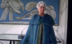 1968:  Full-length image of American art collector Peggy Guggenheim (1898 - 1979) standing in front of a Picasso painting 'On The Beach' at the Peggy Guggenheim museum, Venice, Italy. She wears a light blue cape and a floral dress.  (Photo by Tony Vaccaro/Hulton Archive/Getty Images)