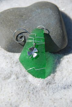 Authentic frosted green sea glass Christmas ornaments with silver shamrock charm. Genuine frosted green sea glass ornament. Dress up your Christmas tree and bring memories of warm summer nights and beach walks with this lovely Christmas ornaments.  The sea glass is genuine frosted green beach glass that was collected on the sandy shores and rocky beaches of Casco Bay, in Coastal Maine. The beach sea glass was carefully selected for both its unique shape, thickness and its color. Each…