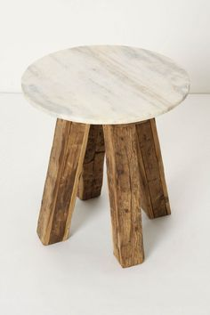 Genova Side Table - Anthropologie.com    Love how solid this thing looks. The texture from the marble top is a nice touch.