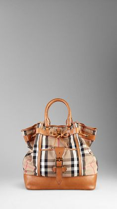 I need this.  Last time I got a new Burberry bag was when the hubs bought me one after our daughter was born.  I would like a new one.  :o)